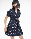 Polka Dotted Dress With Pleated Hem