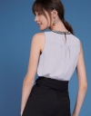 Sleeveless Top With Embellished Tied Neck
